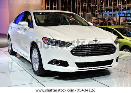 TORONTO-FEBRUARY 16: The new Ford Fusion Energy on display at the 2012 Canadian International Auto Show on February 16, 2012 in Toronto, Canada. - stock photo