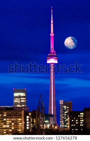 TORONTO - JANUARY 7: CN Tower at Night. One of the highest structures in the world and a tourist landmark as shown on January 7, 2012 in Toronto, Canada. - stock photo