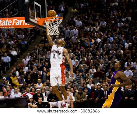 TORONTO - JANUARY 24: Jarrett Jack #1 participates in an NBA basketball game at the Air Canada Centre on January 24, 2010 in Toronto, Canada.  The Toronto Raptors beat the Los Angeles Lakers 106-105. - stock photo