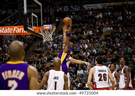TORONTO - JANUARY 24: Lamar Odom #7 participates in an NBA basketball game at the Air Canada Centre on January 24, 2010 in Toronto, Canada.  The Toronto Raptors beat the Los Angeles Lakers 106-105. - stock photo