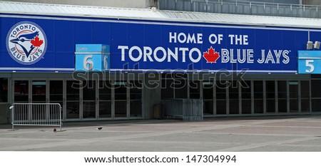 TORONTO - JUL 2: Entrance to the Rogers Centre stadium. Home of the Toronto Blue Jays baseball team. Taken July 2, 2013  in Toronto, Ontario, Canada. - stock photo