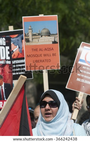 TORONTO-JULY 11: A Muslim middle aged woman chanting slogans during the Al-Quds day rally on July 11, 2015 in Toronto,Canada. - stock photo