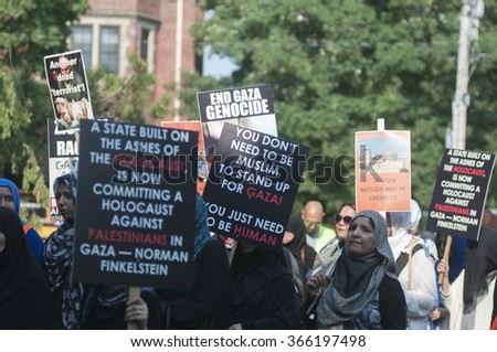 TORONTO-JULY 11: Anti-Israel signs where their, policies towards Palestine being compared with Holocaust during the Al-Quds day rally on July 11, 2015 in Toronto,Canada.
