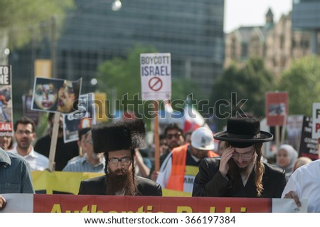 TORONTO-JULY 11: Authentic Israeli Rabbis leading the crowd during the Al-Quds day rally on July 11, 2015 in Toronto,Canada. - stock photo