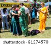 TORONTO – JULY 17:  Girls putting  a sari on at 39th Annual festival of India in July 17 2011 on Central Island in Toronto, Canada. The festival is a popular annual attraction  for the last 39 years. - stock photo