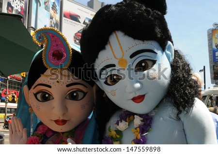 TORONTO - JULY 13:  Mascots of Lord Krishna and goddess Radha posing for the shutterbugs during the 41st Annual Festival of India on July 13, 2013 in Toronto-Canada. - stock photo