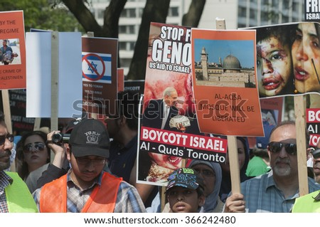 TORONTO-JULY 11: Muslims gathered around  a speaker with banners and signs during the Al-Quds day rally on July 11, 2015 in Toronto,Canada. - stock photo