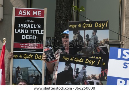 TORONTO-JULY 11: People gathered on the opposite side of the street with signs and banners to oppose the the Al-Quds day rally on July 11, 2015 in Toronto,Canada. - stock photo