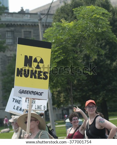 "TORONTO - JULY 5 :People with ""no nukes"" sign  during the Jobs,Justice and Climate rally on July  5, 2015 in Toronto, Canada."