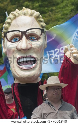 TORONTO - JULY 5 :  Puppet of Ontario Premier Kathleen Wynne during the Jobs,Justice and Climate rally on July  5, 2015 in Toronto, Canada.