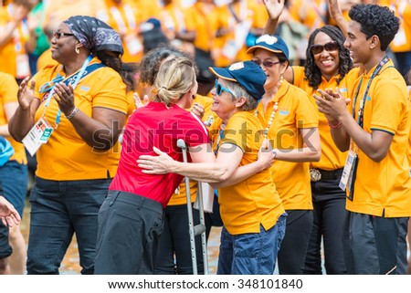 TORONTO,JULY 25,2015: Toronto 2015 Pan Am and Parapan Am Games volunteers are honored by the city at Nathan Phillips Square.The Mayor recognizes the vital help the volunteers gave the event success.