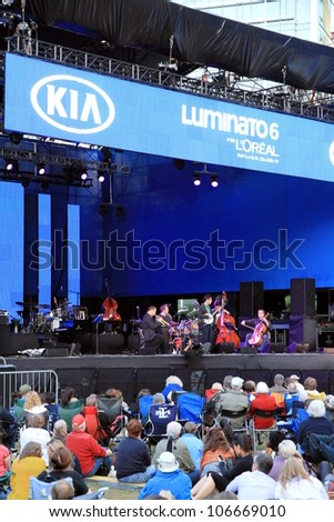 TORONTO - JUNE 13: A concert of the annual Luminato Festival on June 13, 2012 in Toronto. Luminato events take place in multiple indoor and outdoor locations throughout Toronto downtown core. - stock photo