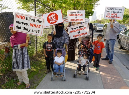 TORONTO-June 04,2015: A group of parents from Valley Park School in Toronto is threatening to pull their kids out of school in protest of the province's new sex-education curriculum - stock photo