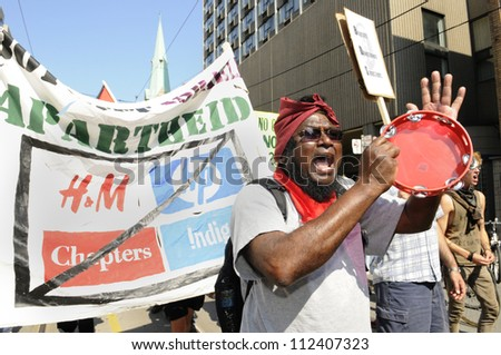 TORONTO-JUNE 25: A muslim man chanting slogans against capitalism during the G20 Protest on June 25, 2010 in Toronto, Canada.