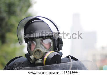 TORONTO-JUNE 26:  A police officer  looking through his  gas masks and ready for any chemical or gas bombs during the G20 Protest on June 26, 2010 in Toronto, Canada. - stock photo