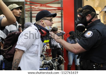 TORONTO-JUNE 26:   A protester having an argument with a police officer during the G20 Protest on June 26 2010 in Toronto, Canada.