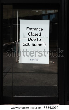 TORONTO-JUNE 23: A sign declaring a closed entrance is shown on June 23, 2010 in Toronto. Preparations are underway for the upcoming G20 Summit. - stock photo