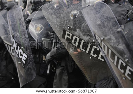 TORONTO-JUNE 26:  A significant presence of Riot Gear during the G20 Protest on June 26, 2010 in Toronto, Canada. - stock photo