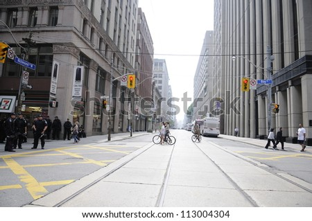 TORONTO-JUNE 27:   Few police officers patrolling the empty downtown streets, a day after the vandals created a mayhem  during the G20 Protest on June 27, 2010 in Toronto, Canada. - stock photo