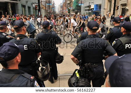 TORONTO-JUNE 27: Large number of Toronto police force block street to prevent 500 protesters on bicycles going close to G20 Convention Centre June 27, 2010 in Toronto.