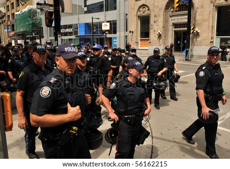 TORONTO-JUNE 27: Large number of Toronto police force is visible on every intersection of downtown Toronto during G20 summit June 27, 2010 in Toronto. - stock photo