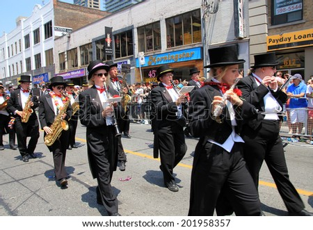 TORONTO - JUNE 29: Orchestra at World Pride Parade in June 29, 2014 in Toronto, Canada.