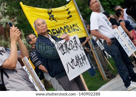 TORONTO - JUNE 2: People join Toronto Association for Democracy in China in the 24th year commemoration ceremony of Tiananmen Square Massacre in Toronto on June 2, 2013.