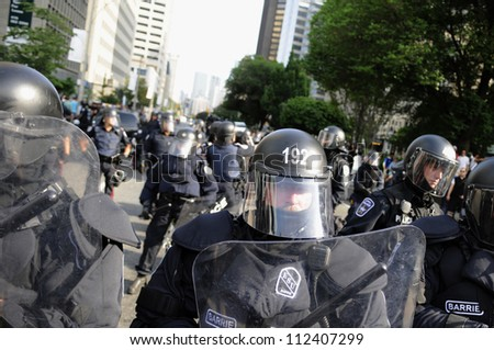 TORONTO-JUNE 25: Police in Riot gear keeping eyes on the protesters  during the G20 Protest on June 25, 2010 in Toronto, Canada.
