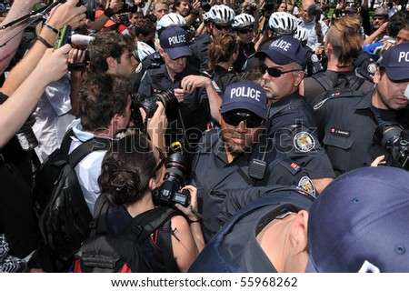 TORONTO-JUNE 25: Police intervenes with protesters at G20 Protest on June 25, 2010 in Toronto, Canada. - stock photo