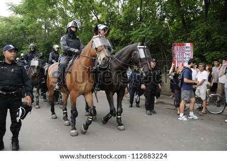 TORONTO-JUNE 27:   Police officers  marching on the streets on horses during the G20 Protest on June 27, 2010 in Toronto, Canada. - stock photo