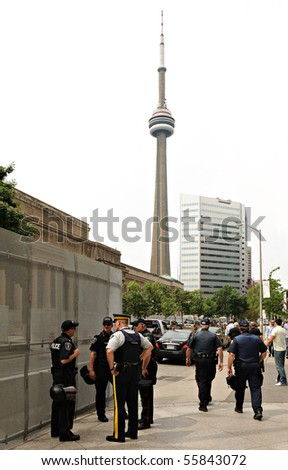 TORONTO-JUNE 23: Police stand guard on June 23, 2010 in Toronto. The G20 Summit will be protected by an estimated 10,000 Canadian law enforcement personnel. - stock photo