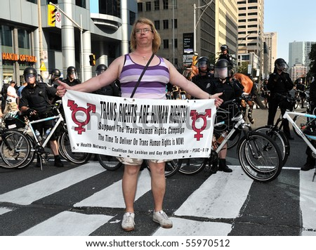 TORONTO-JUNE 25: Protester promotes human right for transgenders  on June 25, 2010 in Toronto, Canada. - stock photo