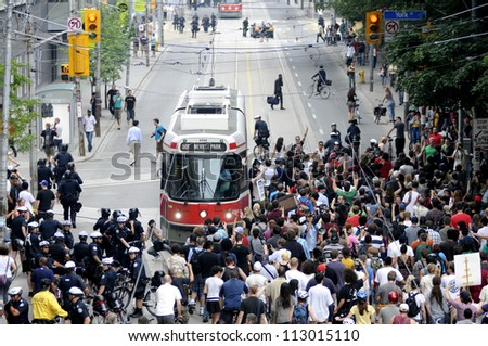 TORONTO-JUNE 28: Protesters clogging the downtown streets and restricting a passage for public transport during the G20 Protest on June 28, 2010 in Toronto, Canada.