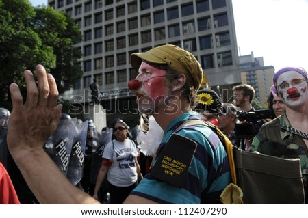 TORONTO-JUNE 25: Protesters dressed as  a clown during the G20 Protest on June 25, 2010 in Toronto, Canada.