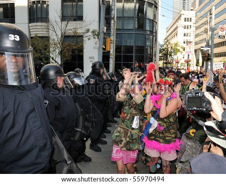 TORONTO-JUNE 25: Protesters dressed as clowns makes fun of Toronto Riot Police  on June 25, 2010 in Toronto, Canada.