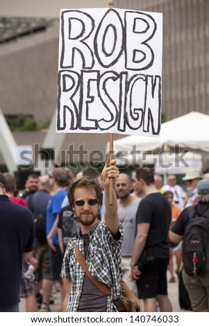TORONTO - JUNE 1 :Protesters gathered outside Toronto city hall  and called for Mayor Rob Ford to resign due to video scandal  June 1, 2013   in Toronto, Canada.