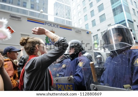 TORONTO-JUNE 26:   Protesters  shouting and yelling in front of the riot  police during the G20 Protest on June 26, 2010 in Toronto, Canada.