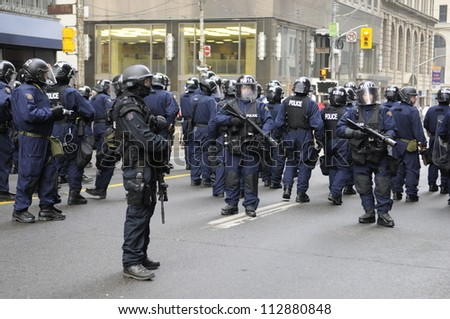 TORONTO-JUNE 26:   Riot police controlling the streets and getting ready for any type of problem  during the G20 Protest on June 26, 2010 in Toronto, Canada. - stock photo