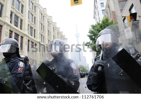 TORONTO-JUNE 26:   Riot police officers protecting the main event venue during the G20 Protest on June 26 2010 in Toronto, Canada.