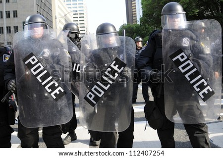 TORONTO-JUNE 25:  Riot police with protective gears during the G20 Protest on June 25, 2010 in Toronto, Canada. - stock photo