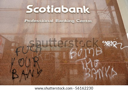 """TORONTO-JUNE 27: """"Scotiabank"""" wall vandalized with graffiti during G20 protest June 27, 2010 in Toronto. - stock photo"""