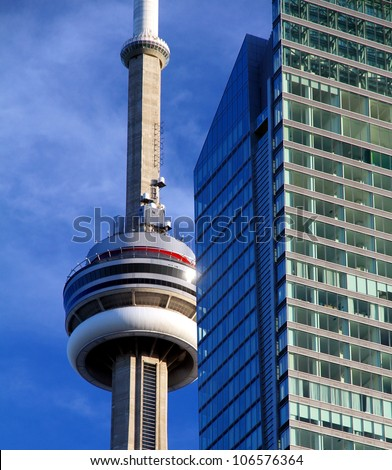 TORONTO - JUNE 13: The CN Tower against a blue sky on June 13, 2012 in Toronto. The CN Tower was completed in 1976 and is the world's tallest free standing structure, standing 553.33 meters tall. - stock photo