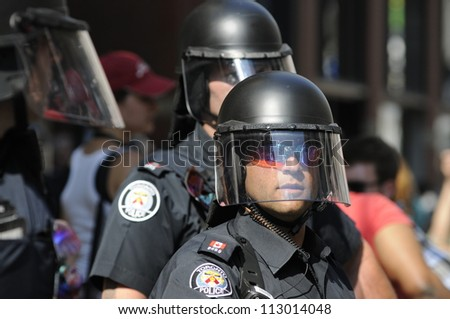 TORONTO-JUNE 25:   Toronto police officers during the G20 Protest on June 25, 2010 in Toronto, Canada. - stock photo