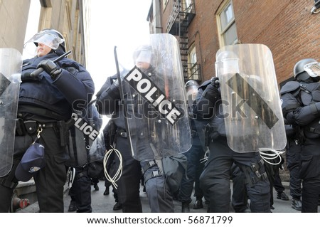 TORONTO-JUNE 25:  Toronto Riot Police lined up  during the G20 Protest on June 25, 2010 in Toronto, Canada. - stock photo