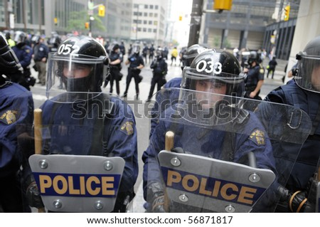 TORONTO-JUNE 26:  Toronto Riot Police  lined up on King-Bay street  during the G20 Protest on June 26, 2010 in Toronto, Canada.