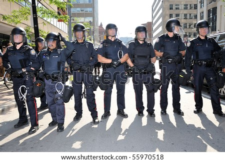 TORONTO-JUNE 25: Toronto Riot Police standing in front of protesters on June 25, 2010 in Toronto, Canada.