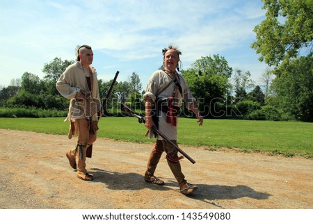 TORONTO - JUNE 15: Two Indian pathfinders at reenactment of the conflict of Revolutionary War between refugees and Loyalists at  Black Creek -  in June 15 2013 in Black Creek Village, Toronto, Canada