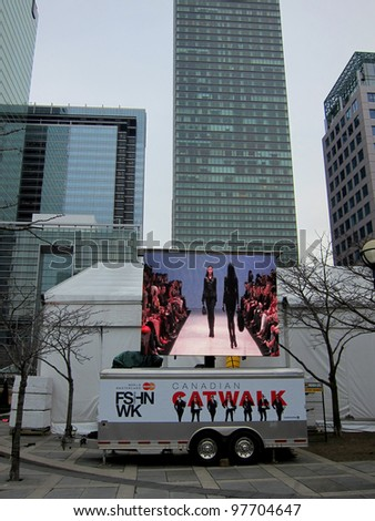 TORONTO - March 15: Video screen at David Pecaut Square near Roy Thomson Hall, the major venue of the Toronto Fashion Week March 15, 2012 in Toronto, Canada