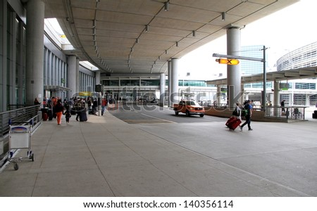 TORONTO - MAY 10: An external view of the Pearson Airport on May 10, 2013 in Toronto. Pearson is by far the largest and busiest airport in Canada and is one of the world's largest transportation hubs. - stock photo