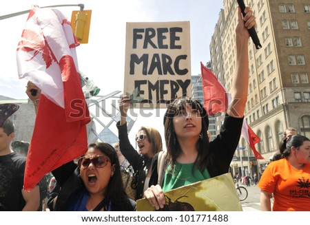 "TORONTO - MAY 5: Marijuana activists chanting slogans to release""Marc Emery"" - cannabis  activist of Canada now jailed during the 14th annual Global Marijuana March on May 5  2012 in Toronto, Canada. - stock photo"